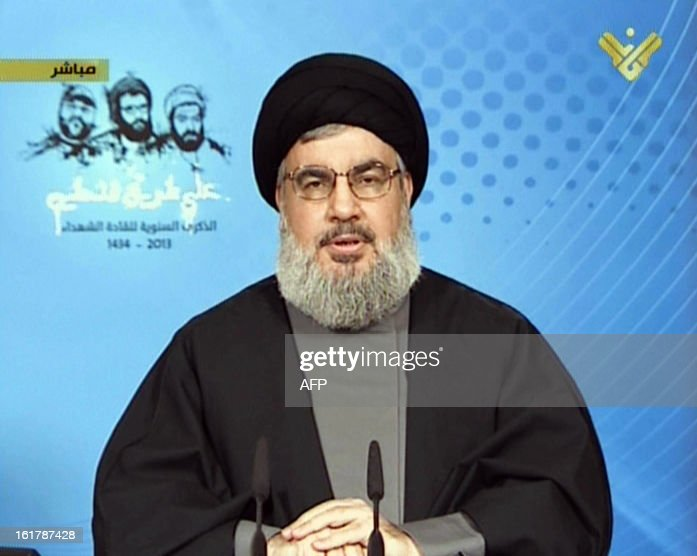 An image grab taken from Hezbollah-run Al-Manar TV station shows Lebanon's Hezbollah chief Hassan Nasrallah speaking during a televised address from an undisclosed location on February 16, 2013. Nasrallah's address came as Hezbollah marked the anniversary of the Israeli killings of Lebanese Hezbollah commanders Imad Mughnieh (L), Abbas al-Mussawi (C) and Ragheb Harb (R). Mussawi was killed on February 16, 1992 in an Israeli air raid on the southern Lebanese village of Nabatiyeh, Harb was assassinated in south Lebanon during Israel's occupation in February 1984 and Mughnieh was killed in a car bombing in the Syrian capital Damascus on February 12 in 2008.