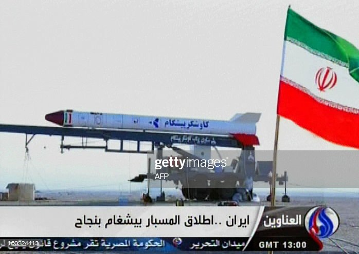 An image grab taken from Iran's Al-Alam TV on January 28, 2013, shows the Iranian flag at an unknown location flying in front of a capsule containing a live monkey which the Tehran-based Arab-language channel said they sent up into space and later retrieved intact. Al-Alam said the monkey was 'alive' after traveling to an altitude of 120 kilometres (75 miles) for a sub-orbital flight as part of 'preparations for sending a man into space,' which is scheduled for 2020. AFP PHOTO/AL-ALAM TV ==RESTRICTED TO EDITORIAL USE - MANDATORY CREDIT 'AFP PHOTO / AL-ALAM TV' - NO