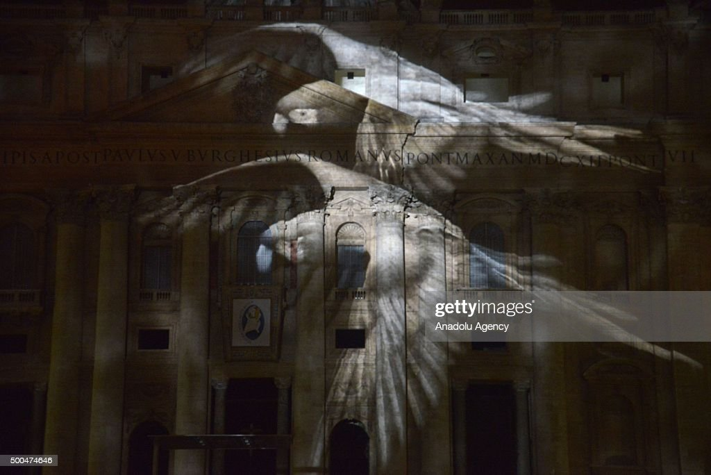 An image is seen as it is projected on St. Peters Basilica's front side during the show Fiat Lux : Illuminating Our Common Home within the Roman Catholic Churchs yearlong Jubilee of Mercy at the Vatican on December 8, 2015. One of the aim of the show is to show solidarity with COP21 talks in Paris.
