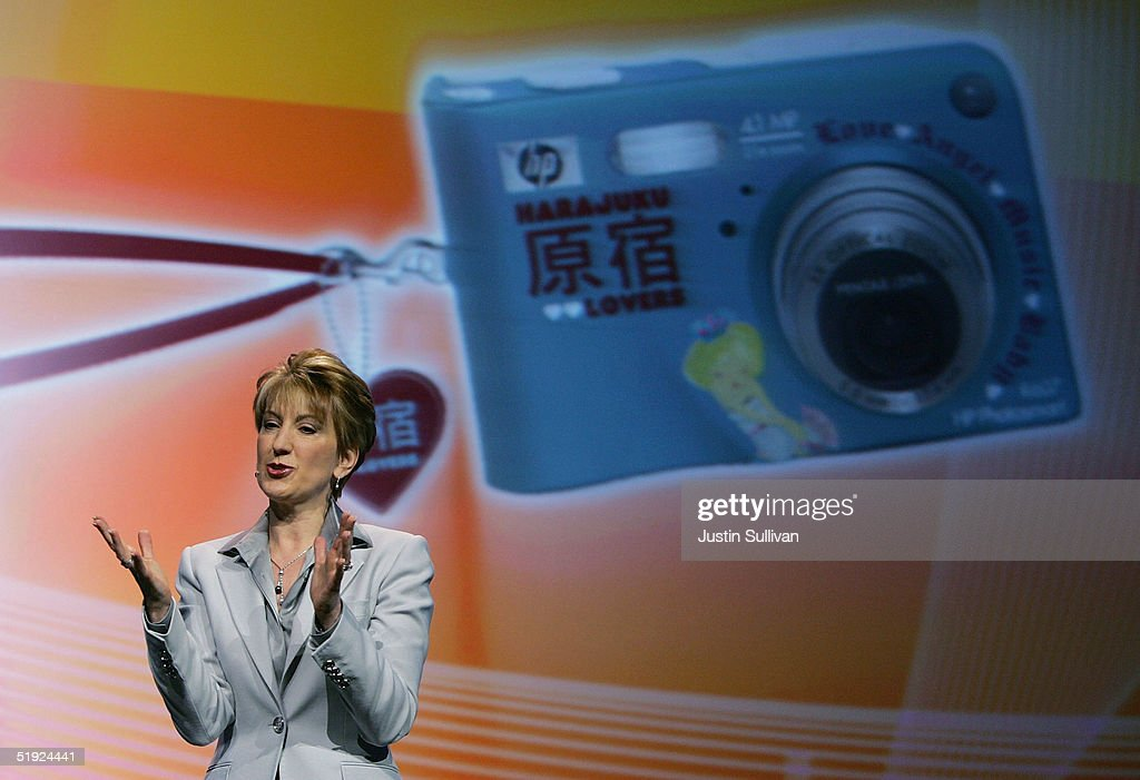 An image of a digital camera designed by musician Gwen Stefani is projected behind HP CEO Carly Fiorina as she delivers a keynote address at the 2005 Consumer Electronics Show January 7, 2005 in Las Vegas, Nevada. The 1.5 million square foot electornic gadget show runs through January 9 and is expected to attract over 120,000 attendees.