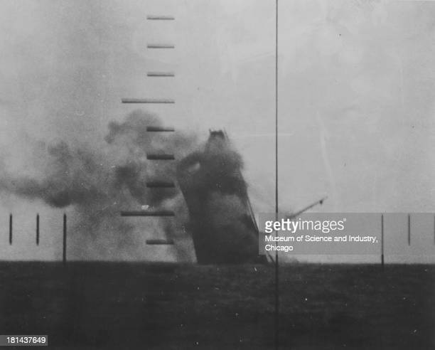 An image of a Japanese cargo ship sinking after being struck by torpedoes from the USS Wahoo as viewed from the periscope April 21 1943