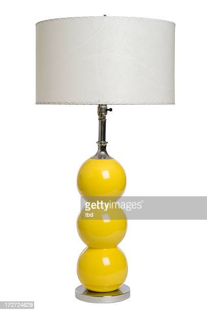 An image of a modern yellow lamp against a white background