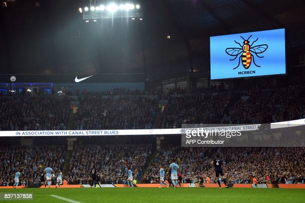 An image of a worker bee a symbol of solidarity after the Manchester terror attacks and including the colours of Catalonia above the the legend...
