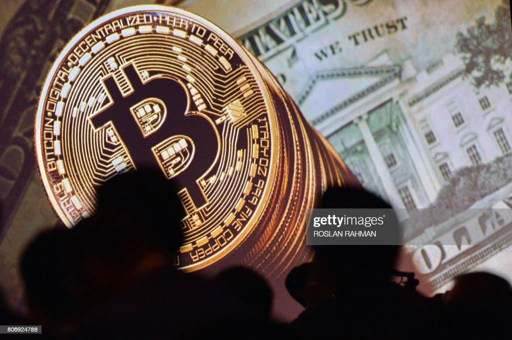 Bitcoin tops $18,000 in debut on major bourse