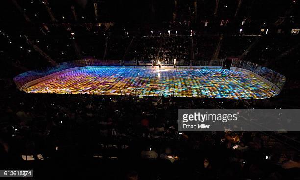 An image of colored lights is projected on the ice before a preseason game between the Colorado Avalanche and the Los Angeles Kings at TMobile Arena...