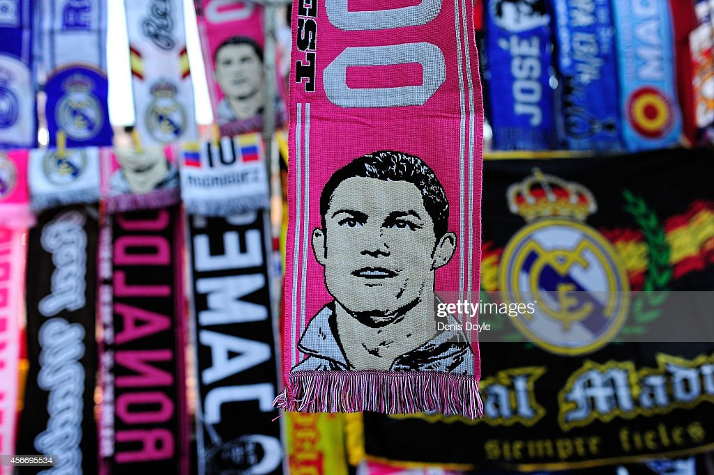 An image of Cristiano Ronaldo of Real Madrid is seen on a scarf for sale at a stall outside the Estadio Santiago Bernabeu prior to the La Liga match...