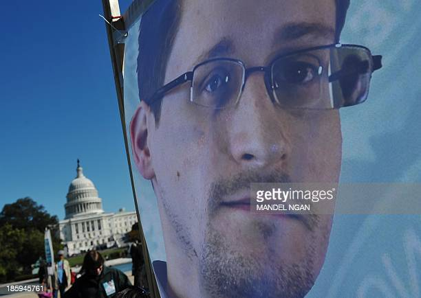 An image of Edward Snowden on the back of a banner is seen infront of the US Capitol during a protest against government surveillance on October 26...