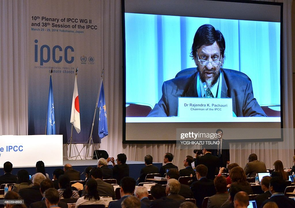 An image of Intergovernmental Panel on Climate Change (IPCC) chairman Rajendra Pachauri is projected onto a screen as he delivers a speech at the opening session of the 10th plenary of the IPCC Working Group II in Yokohama, suburban Tokyo on March 25, 2014. International scientists gathered near Tokyo for a week-long meeting centred on a grim climate change report that warned of floods and drought that could stoke conflicts and wreak havoc on the global economy. AFP PHOTO / Yoshikazu TSUNO