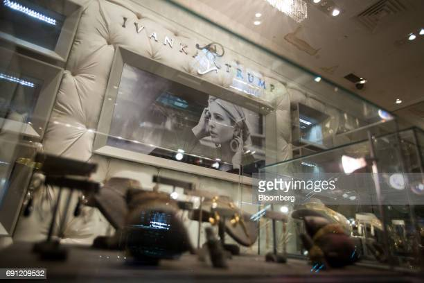 An image of Ivanka Trump is seen from the window of the Ivanka Trump Collection store at Trump Tower in New York US on Thursday June 1 2017 Two...
