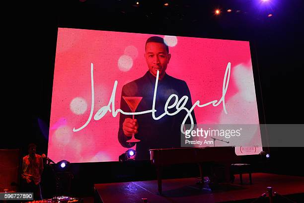 An image of John Legend holding Belvedere Vodka on display at the as Belvedere Presents One Night for Life with John Legend at the Apollo Theater at...