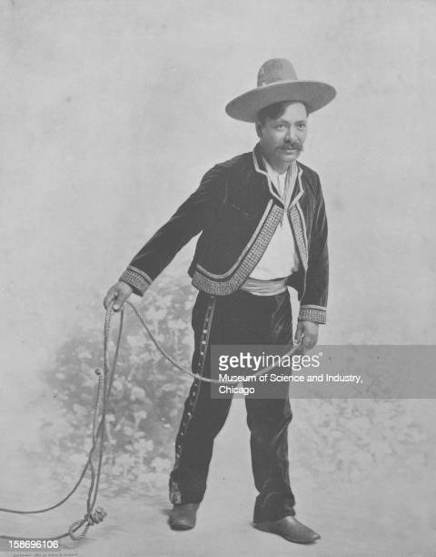 An image of Jose Maria Garcia a Mexican cowboy from Chihuahua in Northern Mexico that worked in Buffalo Bill's Wild West Show holding a lasso and...