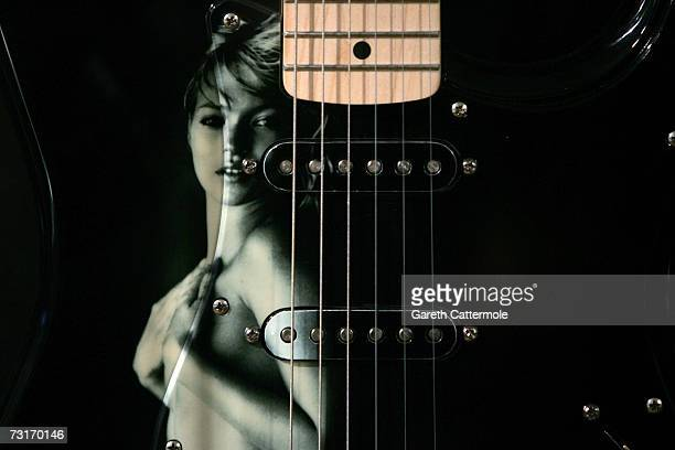 An image of Kate Moss by Bryan Adams appears on a guitar at the Born To Rock Exhibition at Harrods on February 1 2007 in London England Guitars worth...