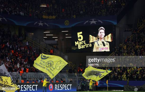 An image of Marc Bartra is shown on the screen after he was injured in the team coach attack prior to the UEFA Champions League Quarter Final first...