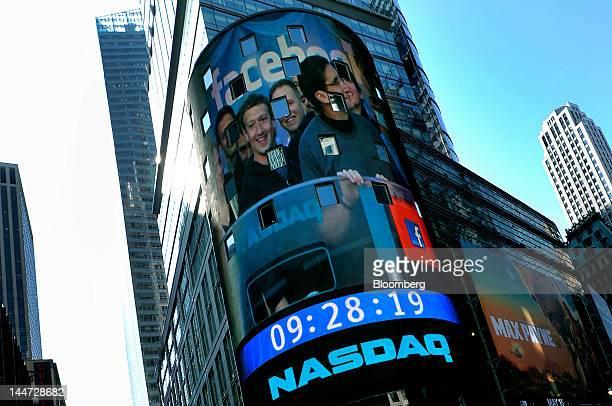 An image of Mark Zuckerberg chief executive officer of Facebook Inc left with Robert Greifeld chief executive officer of Nasdaq OMX Group Inc right...