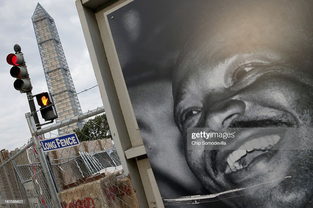 An image of Martin Luther King, Jr. hangs on the wall outside the construction site for the new National Museum of African American History and Culture on the National Mall October 1, 2013 in Washington, DC. National Park Service park facilities and grounds were closed and more than 21,000 of the service's employees were furloughed after Congress was unable to agree on a federal budget and shut down the goverment for the first time in 17 years.