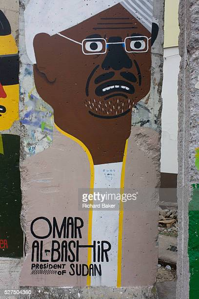 An image of Omar alBashir President of Sudan adorns an old section of the old Berlin Wall opposite the former Checkpoint Charlie the former border...