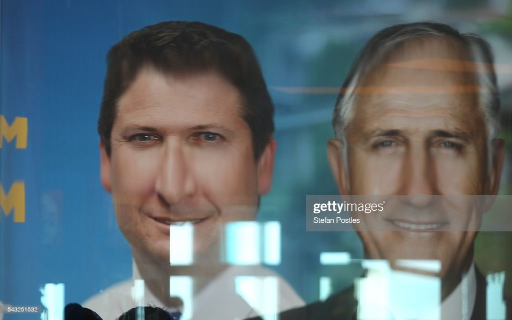 An image of Prime Minister Malcolm Turnbull and Liberal Member for Hindmarsh Matthew Williams is reflected in a window of the Glenelg Surf Life Saving Club on June 27, 2016 in Adelaide, Australia. The Prime Minister opened defence contractor Raytheon's new naval and integration headquarters.
