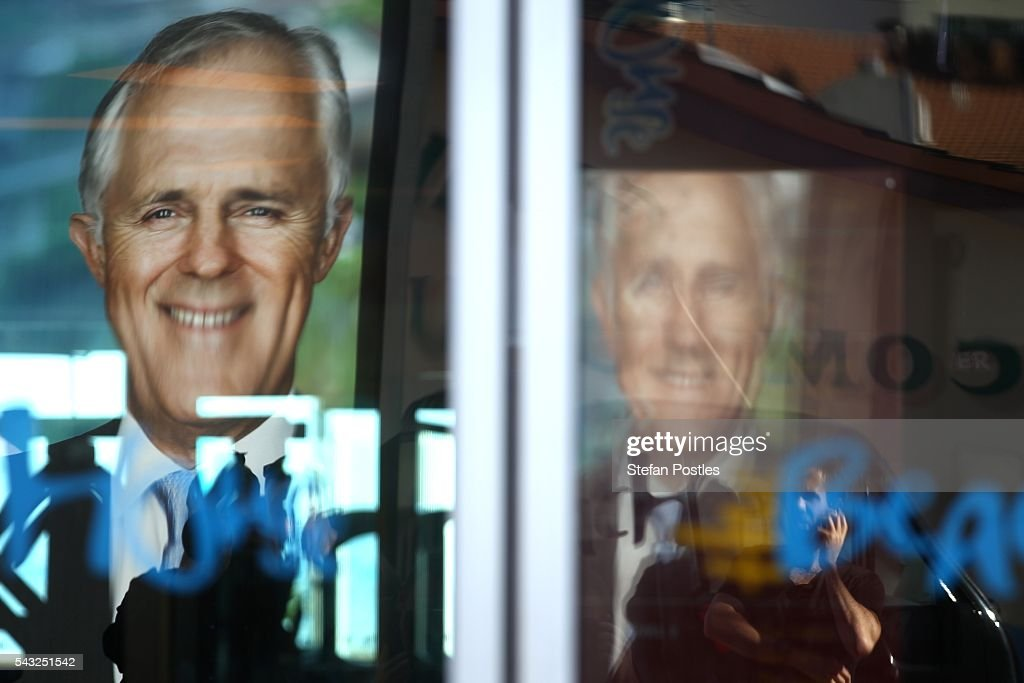 An image of Prime Minister Malcolm Turnbull is reflected in a window of the Glenelg Surf Life Saving Club on June 27, 2016 in Adelaide, Australia. The Prime Minister opened defence contractor Raytheon's new naval and integration headquarters.