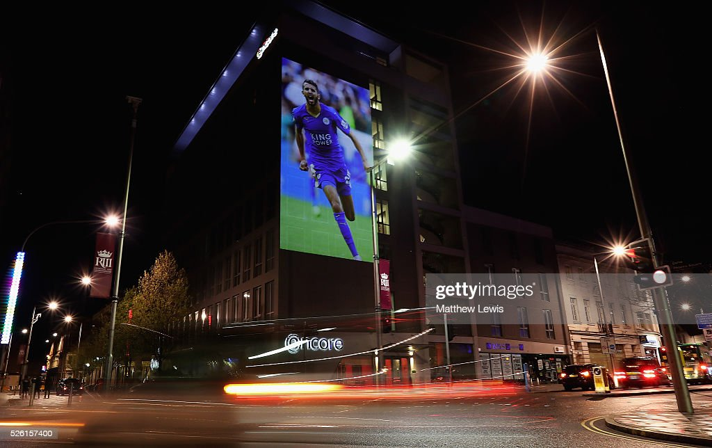 An image of Riyad Mahrez of Leicester City is projected onto the Ramada Encore hotel during a Leicester Backing the Blues Campaign in support of Leicester City on April 29, 2016 in Leicester, England.