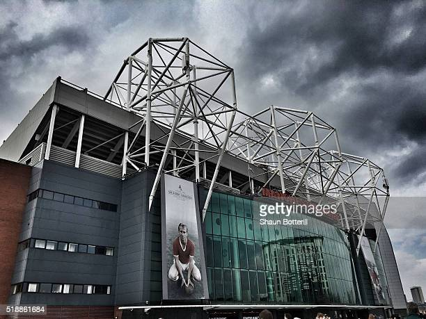 An image of Sir Bobby Charlton is seen on the South Stand prior to the Barclays Premier League match between Manchester United and Everton at Old...