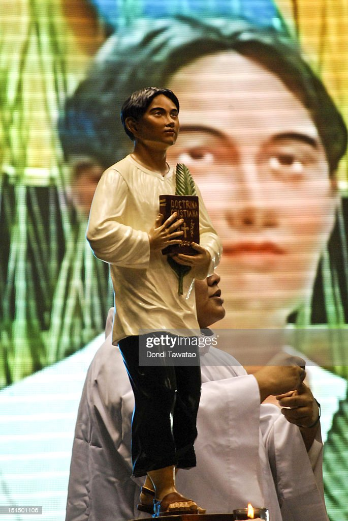 An image of St Pedro Calungsod, the Philippines' second saint is perched on the altar of a church during mass on October 21, 2012 in Manila, Philippines. Millions across the Philippines celebrated the canonization of the 17-year-old Filipino missionary, who was killed while trying to convert locals on the Pacific island of Guam 340 years ago. The Philippines is the only country in Southeast Asia with a predominantly Catholic majority, with around 80 percent practicing the faith.