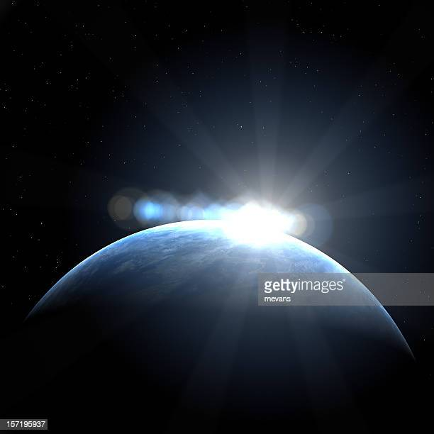 An image of sunrise over earth from space