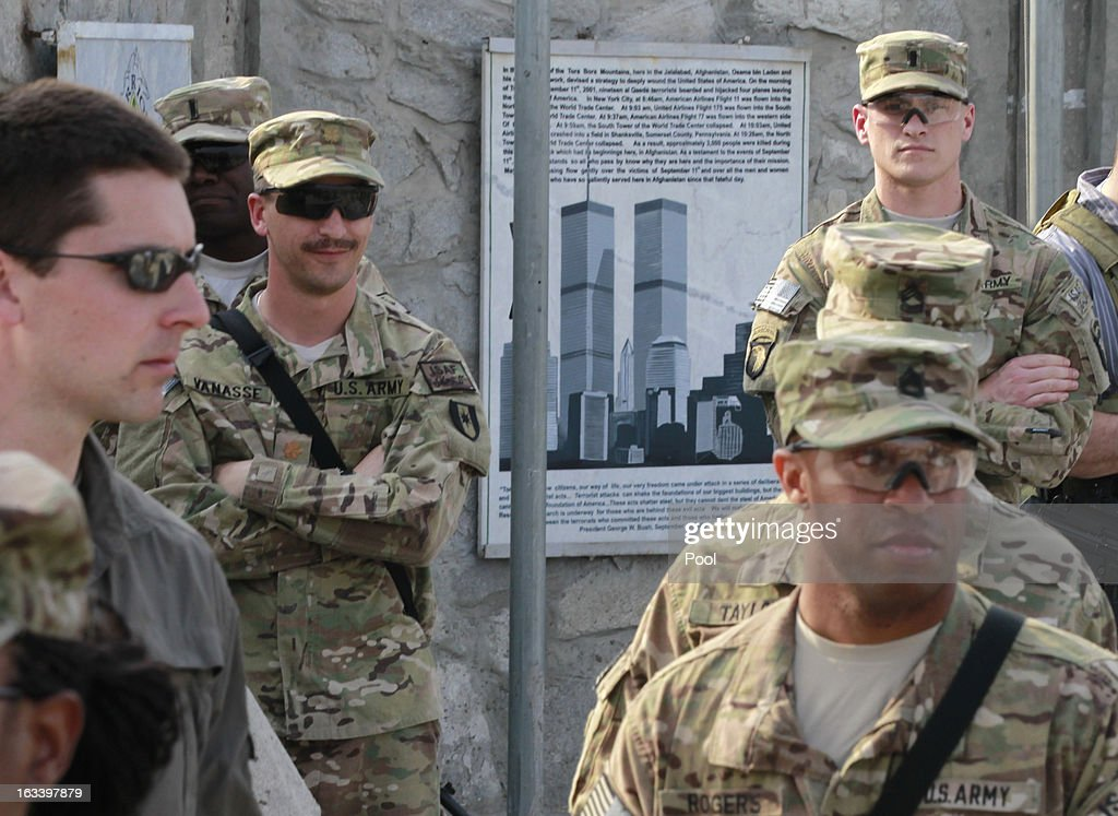 An image of the former World Trade Center towers is displayed near US soldiers as they are visited by US Defense Secretary Chuck Hagel at Jalalabad Airfield on March 9, 2013 near the southeast of Jalalabad city, Afghanistan. Hagel is on his first official trip since being sworn in as US President Obama's Defense Secretary.