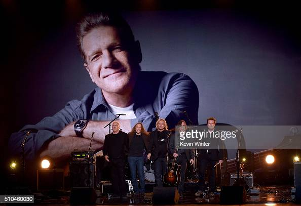 An image of the late Glenn Frey is displayed on a video screen as recording artists Bernie Leadon Timothy B Schmit Joe Walsh Jackson Browne and Don...