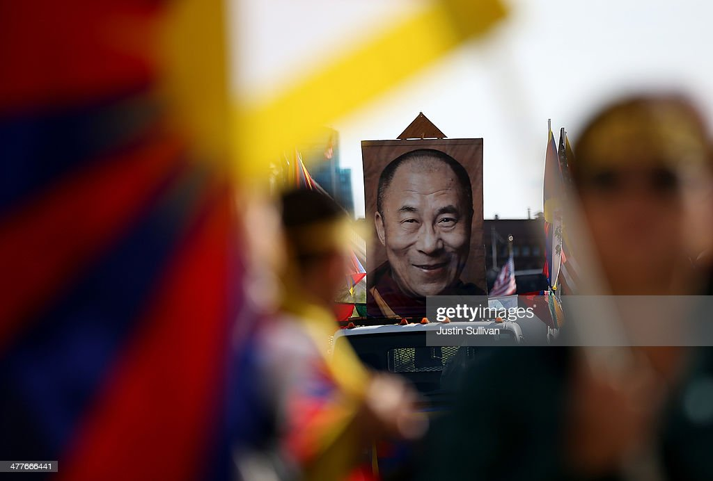 An image of Tibetan spiritual leader His Holiness the Dalai Lama is displayed during a demonstration outside of San Francisco City Hall on March 10, 2014 in San Francisco, California. Hundreds of activists marked the 55th anniversary of the 1959 Tibetan uprising and the fifth anniversary of Tibetan self-immolation protests in Tibet.
