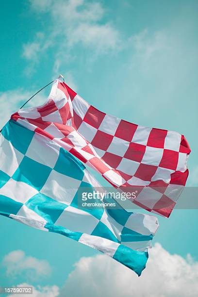 An image of two checkered flags shot from below