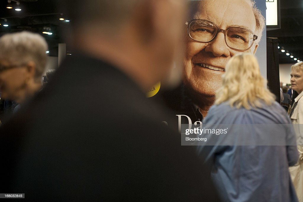 An image of Warren Buffett, chairman and chief executive officer of Berkshire Hathaway Inc., stands on display as shareholders tour the exhibition floor during the Berkshire shareholders meeting in Omaha, Nebraska, U.S., on Saturday, May 4, 2013. Berkshire Hathaway Inc.'s cash hoard hit a record as first-quarter profit jumped 51 percent on gains from equity-linked derivatives and insurance operations. Photographer: Daniel Acker/Bloomberg via Getty Images