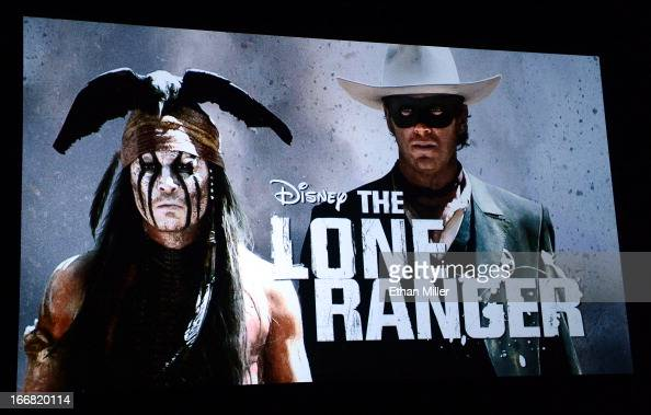 An image on screen during at a Walt Disney Studios Motion Pictures presentation shows actor Johnny Depp as the character Tonto and actor Armie Hammer...