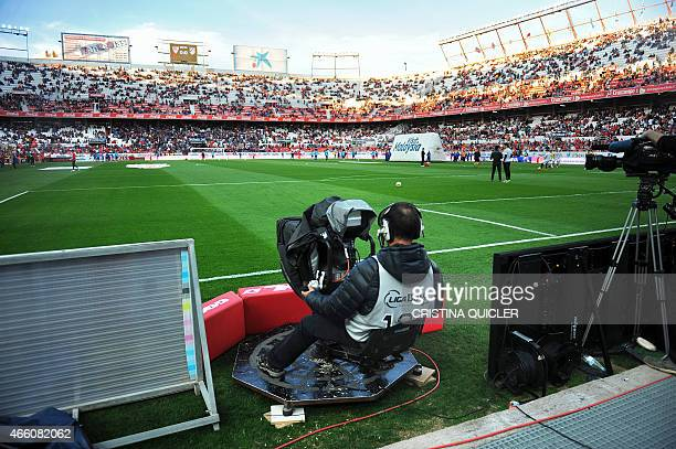 An image taken on March 1 2015 shows a television cameraman working during the Spanish league football match Sevilla FC vs Club Atletico de Madrid at...