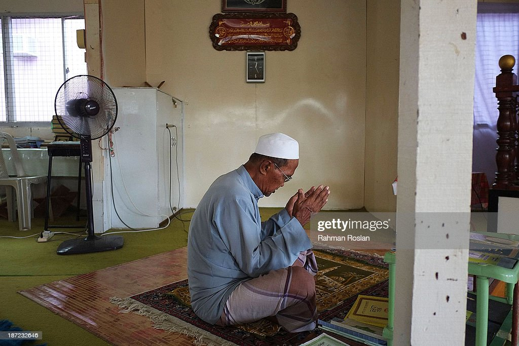 An imam recites a prayer in a small mosque at Kampung Air on November 7, 2013 in Bandar Seri Begawan, Brunei Darussalam. Sultan Hassanal Bolkiah has announced the introduction of a new Sharia penal code to be applied only to Muslims in the East Asian country. The Sultan of Brunei said the phasing in of the new code would begin in six months with reports that punishments could include stoning for offences such as adultery.