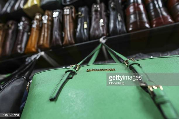 An imitation Michael Kors bag sits on display at a leather goods store in the Dharavi area of Mumbai India on Tuesday July 18 2017 India's new goods...