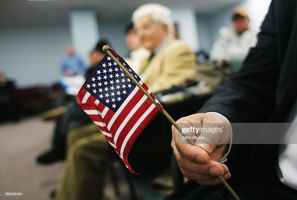 An immigrant from India holds a flag wihile waiting for a naturalization ceremony to become a U.S. citizen at the district office of U.S. Citizenship and Immigration Services (USCIS) on January 28, 2013 in Newark, New Jersey. Some 38,000 immigrants became U.S. citizens at the Newark office alone in 2012.