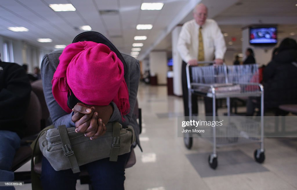 An immigrant from Togo awaits an interview to receive a citizenship certificate for her child at the U.S. Citizenship and Immigration Services (USCIS), district office on January 29, 2013 in New York City. Some 118,000 immigrants applied for U.S. citizenship and 2,500 children received citizenship certificates in the New York City dictrict in 2012. Although minors of naturalized immigrants usually receive U.S. citizenship, they must go through a process at the USCIS in order to receive legal certificates.