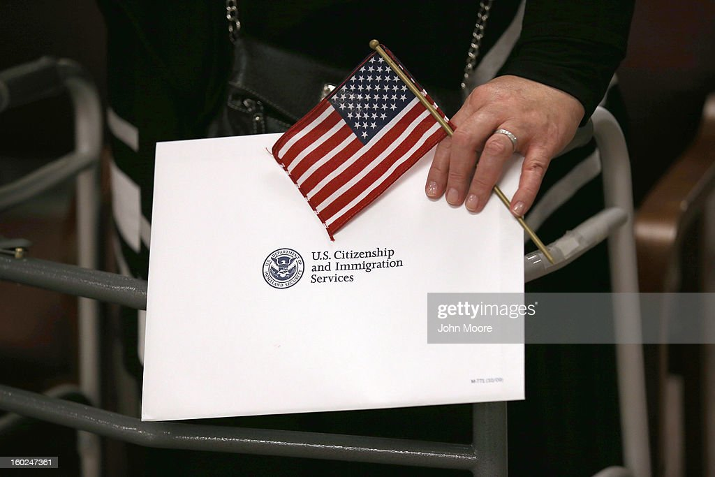 An immigrant prepares to become a U.S. citizen at a naturalization ceremony at the district office of U.S. Citizenship and Immigration Services (USCIS) on January 28, 2013 in Newark, New Jersey. Some 38,000 immigrants became U.S. citizens at the Newark office alone in 2012.