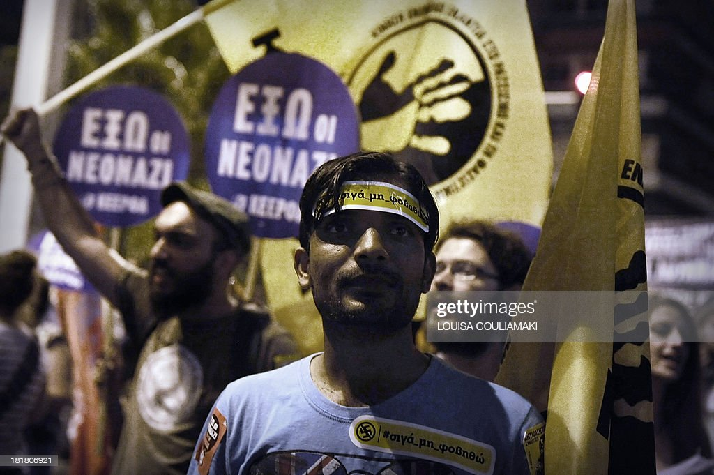 An immigrant protester, bearing a sticker on his forehead, reading: 'I Won't Fear', marches on September 25, 2013 during a massive demonstration in Athens heading toward the offices of the neo-Nazi party Golden Dawn. Greek police clashed with protesters in Athens late September 25 at the end of a huge march sparked by the murder of an anti-fascist musician, allegedly at the hands of a self-confessed neo-Nazi. Protesters were seen hurling petrol bombs at riot police, who responded with tear gas a few hundred meters (yards) from the headquarters of the Golden Dawn.