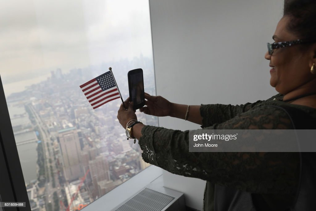 An immigrant takes a selfie after becoming a U.S. citizen at a naturalization ceremony held atop the One World Trade Center on August 15, 2017 in New York City. Thirty immigrants took the oath of citizenship to become American citizens at the first such ceremony to be held at One World Trade Center, which at 1,776 feet high is the tallest building in the Western Hemishere.