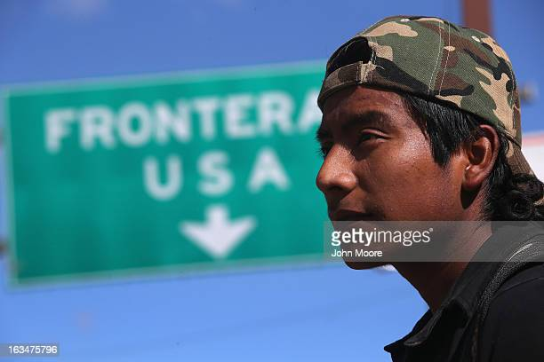 An immigrant walks near the USMexico border after eating breakfast at the Kino Border Initiative center for migrants March 10 2013 in Nogales Mexico...