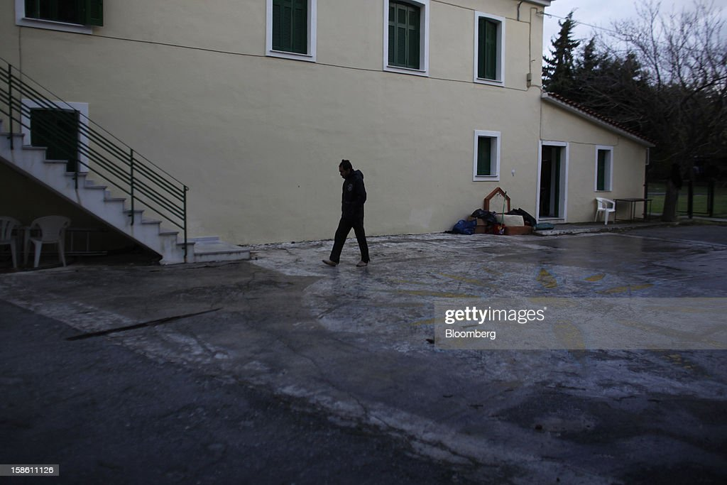 An immigrant walks through the Pikpa summer camp, operated by Medecin Sans Frontiers (MSF) as a temporary shelter for refugees, near the town of Mytilene on the island of Lesbos, Greece, on Sunday, Dec. 9, 2012. In recent months, Lesbos has become a hot spot for migrants as Greece struggles to cope with waves of refugees from Middle Eastern conflict even as it reels from economic crisis at home. Photographer: Kostas Tsironis/Bloomberg via Getty Images