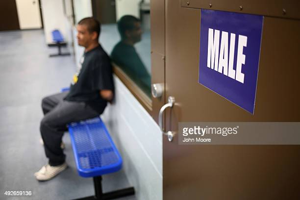 An immigrants waits to be processed while detained at a US Immigration and Customs Enforcement center on October 14 2015 in Camarillo California ICE...