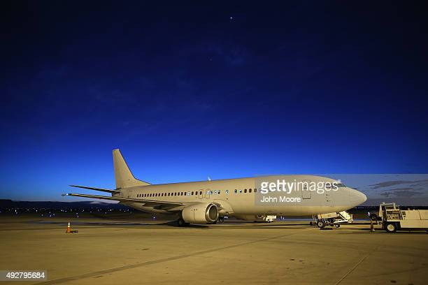 An Immigration and Customs Enforcement charter jet wait to depart on October 15 2015 in Mesa Arizona The plane carrying undocumented immigrants flew...
