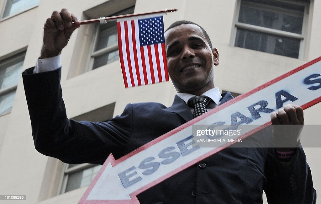 An impersonator of US Presidente Barack Obama takes part in the 'Cordao do Bola Preta' traditional carnival band parade along Rio Branco avenue, in downtown Rio de Janeiro, Brazil on February 9, 2013. Carnival was under way in Rio on Saturday with millions set to take to the streets for days of rowdy, joyous parades and festivities, bringing the nation to a halt for its annual wild party. Nearly 800,000 Brazilian and foreign tourists were expected join Rio's six million residents in the celebrations, whose climax comes on Sunday and Monday with the city's top samba schools putting on their extravagant processions led by sexy dancing queens.