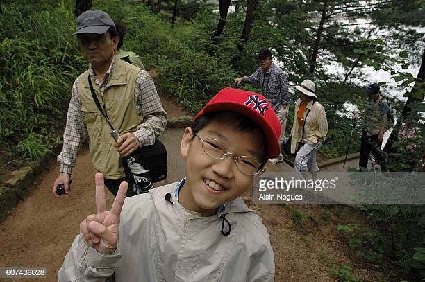 An impish South Korean child visits the Kumgang Mounts Since early september the cty of Kaesong has been opened to South Koreans and a oneday trip...