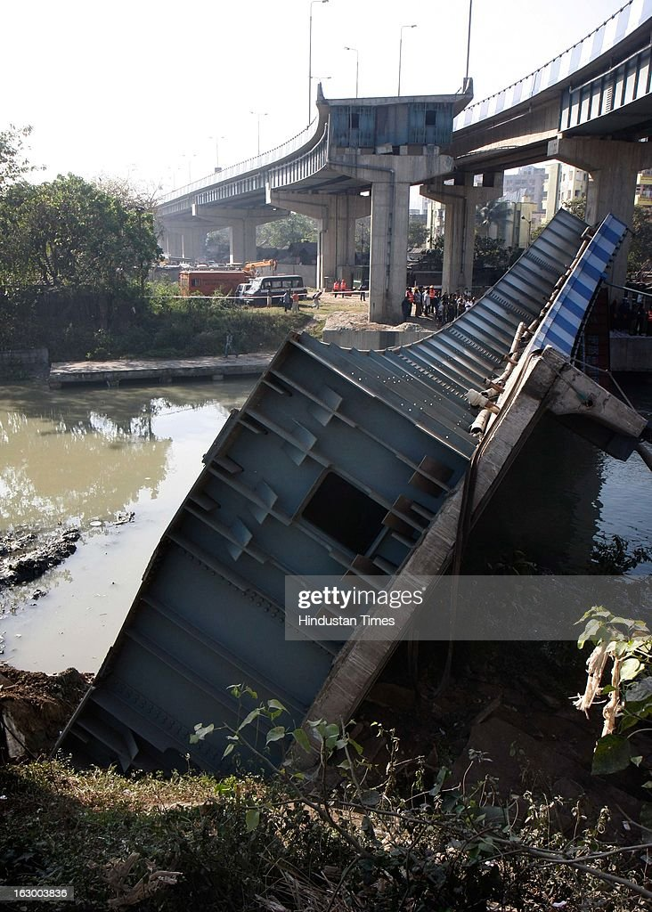 An important flyover was collapsed which connects VIP road and Eastern By-pass towards airport at Ultadanga crossing on March 3, 2013 in Kolkata, India. Dameged truck stuck between pillars and broken portion of flyover. Truck driver and two helper was injured seriously in the incident.
