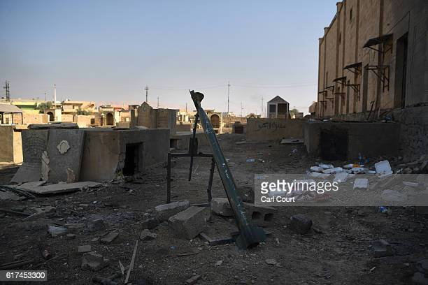 An improvised rocket built by Islamic State is positioned in the graveyard of a Christian church that was retaken by Iraqi forces during the...
