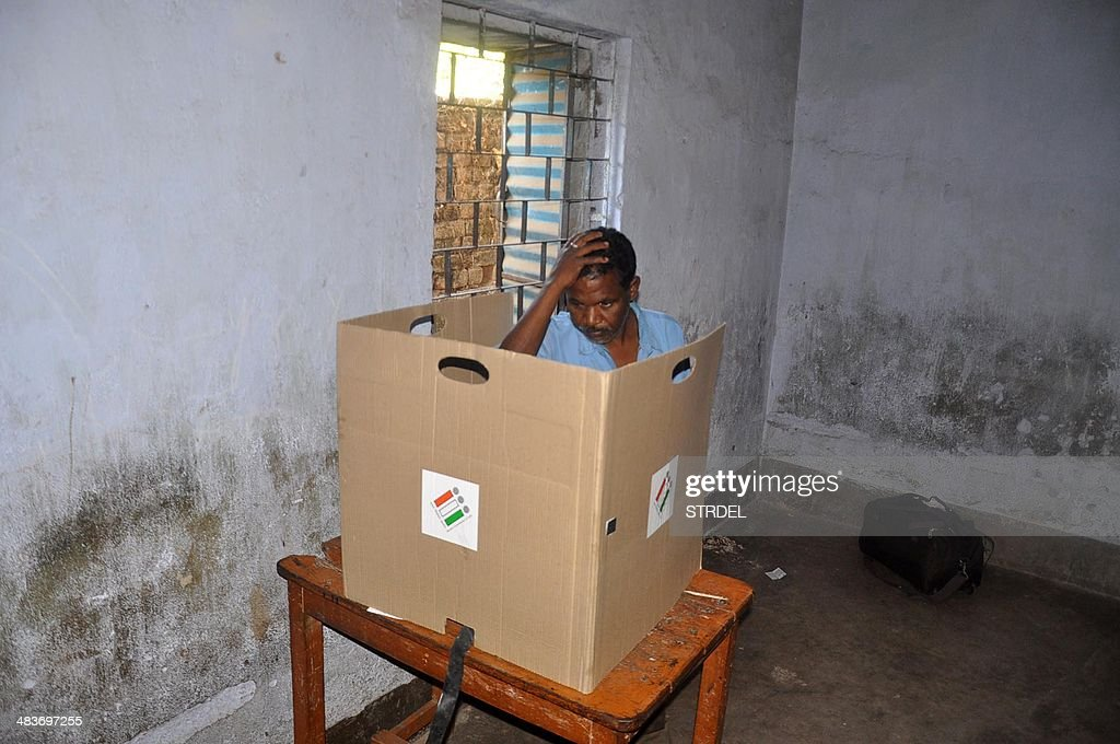 An Indan resident gestures as he prepares to cast his vote at a polling station in Lohardaga District on April 10 during the third stage of voting...