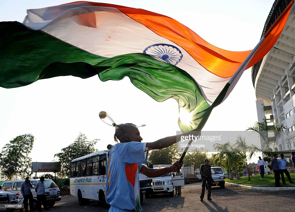 An India fan waves the national flag outside of the stadium used by South Africa for a Proteas nets session at VCA Stadium on March 11, 2011 in Nagpur, India.